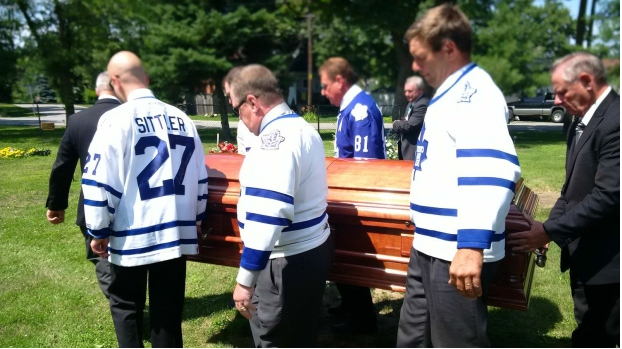 pall bearers wearing Leafs jerseys