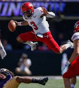 Vernon Adams Jr leaps over Husky